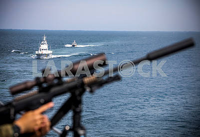 Boats and machine guns