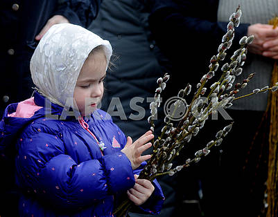 The girl holds the willow twigs