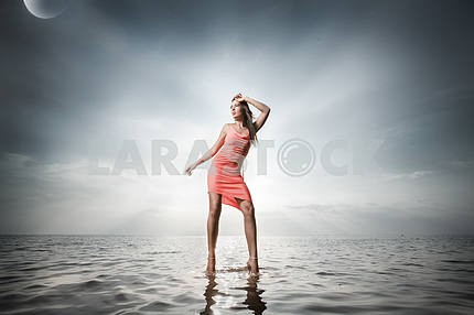Beautiful girl standing on the water