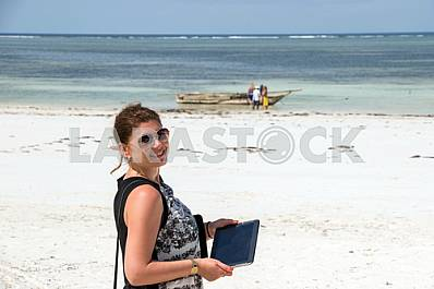 Zanzibar, a girl stands on the shore of the Indian Ocean