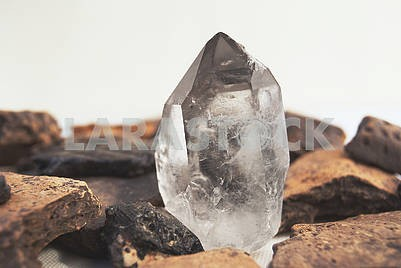 Large quartz crystal on white background close-up