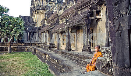 Little Buddhist monk in the ruins of Angkor