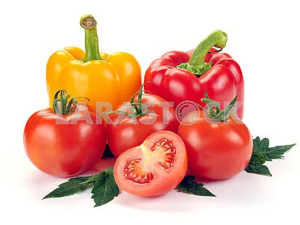 tomatoes and peppers with leaves