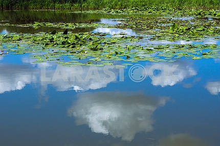Reflection in the lake blue sky with clouds