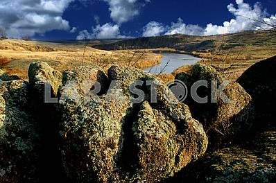 .Bolshoy Boulder Monastyryshche Autumn, River cascades tract, against the blue sky