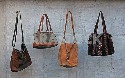 Old brown female leather handbags