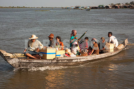 Boat loaded with villagers on the water floating on the Tonle Sap lake in Cambodia.