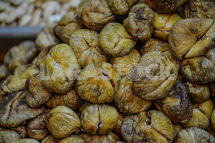 Dried figs on a heap close-up.