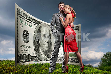 Portrait young beautiful couple. money, 100 american dollars