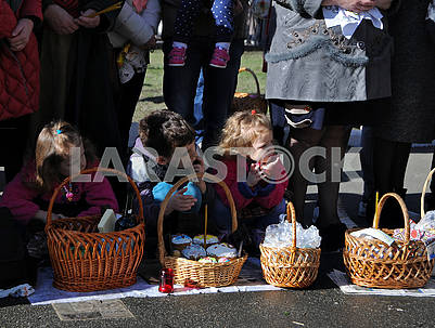 Children near Easter baskets