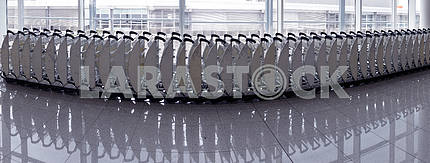 Trolleys luggage in a raw in airport.