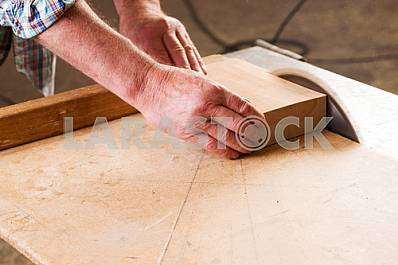Carpenter tools on wooden table with sawdust. Circular Saw. Carpenter workplace top view