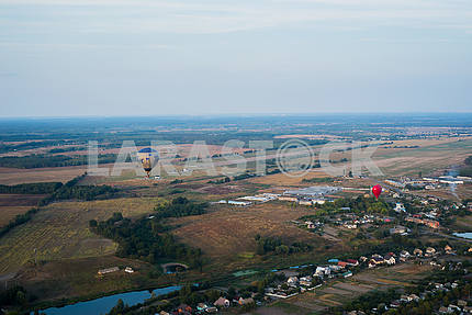 A view from high above - landsacape. little town and the horisont. Balloon flight. basket 1000 meters. having fun, romantic flight