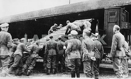 German soldiers loading equipment
