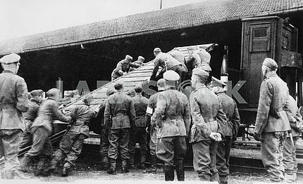 German soldiers loading equipment