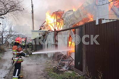 Rescuers extinguish the fire
