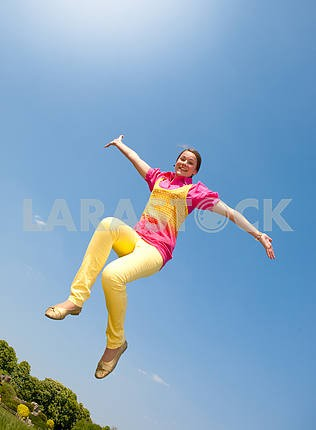Happy smiling girl - jumping.