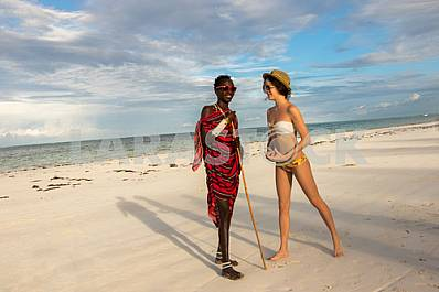 Zanzibar, a girl and a male Masai warrior