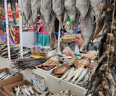 """A woman sells fish in the market """"Privoz"""" July 5, 2012"""