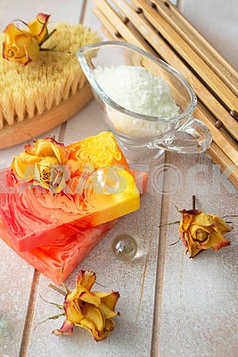 Spa treatment set with sea salt, dry rose flowers and aroma soap