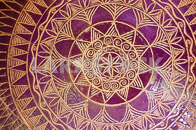 Traditional pattern of tile mandala bowl pottery. Golden and purple colors