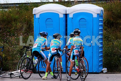 Cyclists near toilets