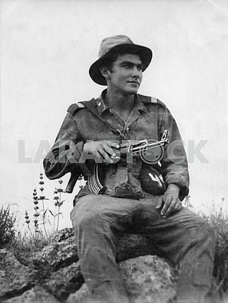 A soldier with a gun Kalashnikov