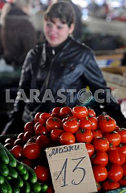 """A woman sells tomatoes in the market """"Privoz"""" April 6, 2012"""