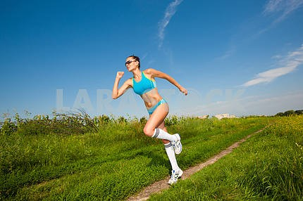 young athletic girl running