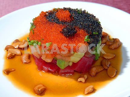 Salad from caviar and vegetables