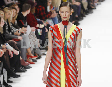 Model with red stripes dress  demonstrates outfit by brand Label One