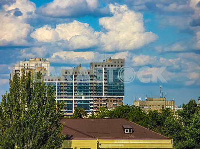 New multi storey building on a background of blue sky with cloud