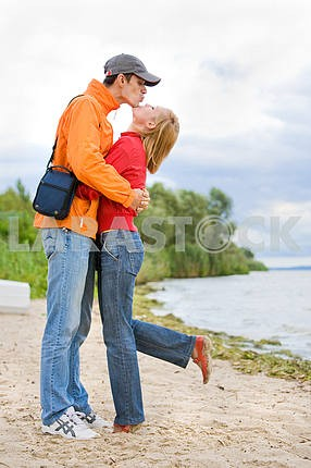 Young love Couple kissed on on coast of river.
