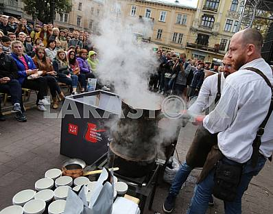 Barista brews coffee in Lviv