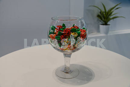 Glass vase with sweets on the table