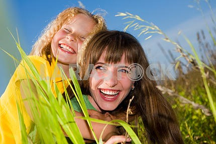 Happy mother and daughter on garden
