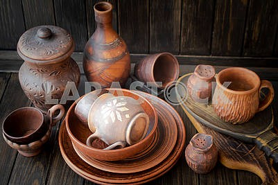 Clay dishes. A set of pots made of clay . Belarus traditional design pattern.
