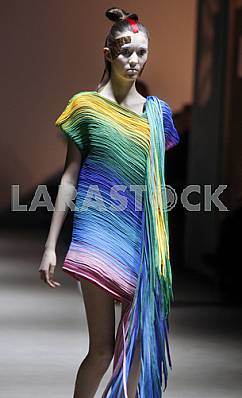Model in the colored dress demonstrates outfit by Ukrainian designer Sistan Varvara
