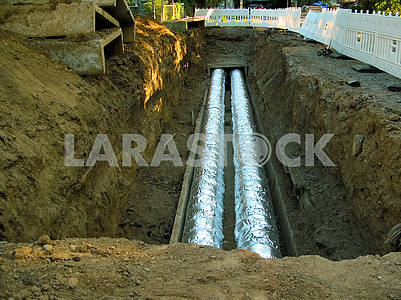 Replacing and insulating large water pipes in the ground.