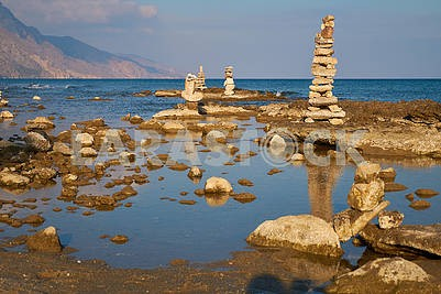 Stone figures on a sea