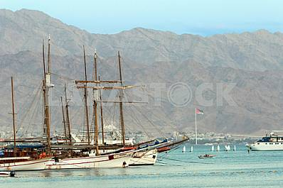 Sailboats with mountains on background in Eilat