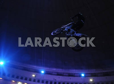 Motobiker under the circus dome