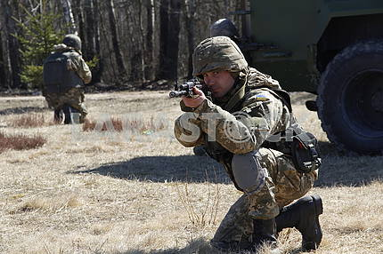 Serviceman with automatic weapons