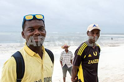 Zanzibar, the three men on the background of the ocean