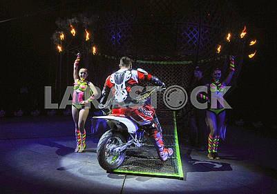 Circus motorcyclist and jugglers