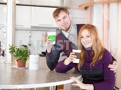 Young happy couple drinking tea in the morning