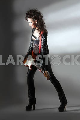 one woman playing  guitar