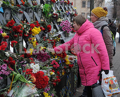 Laying flowers on the Alley of Heroes of Heavenly Hundreds