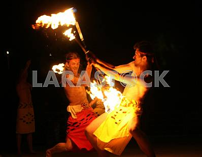Artists juggle flaming maces