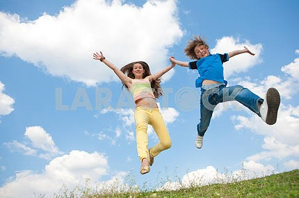 Girl and boy jumping. Soft focus. Focus on eyes